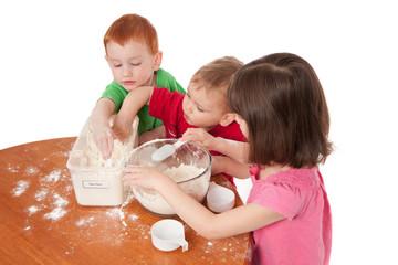 Preschooler kids making mess in kitchen