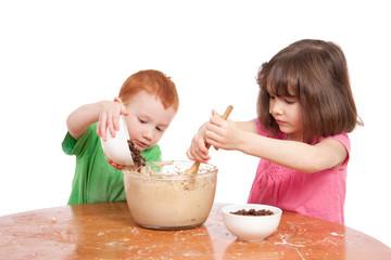 Kids mixing cake