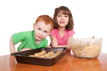 Kids with chocolate chip cookes to bake