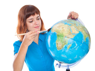 a girl is painting on the globe