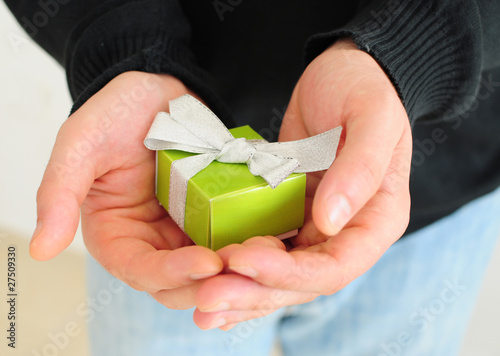 Man holding small present
