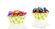 colorful little candy in  modern cupake molds isolated over whit