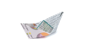Close up origami newspaper ship isolated on white background