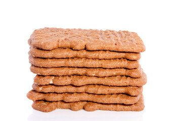 a stack of Dutch spiced Speculaas cookies isolated on white back