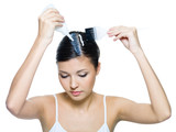 young woman dyeing hairs on white background poster