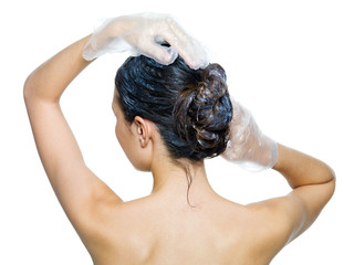 rear view of woman dyeing hairs  -isolated