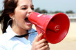 Young Woman Using Megaphone. Model Released