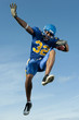 Football player jumping with ball
