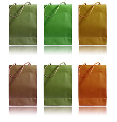 Shopping paper bags in different colors isolated on white