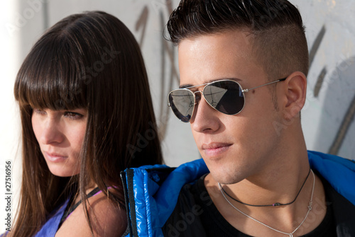 Young couple urban fashion close-up portrait