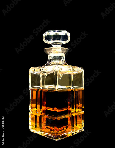 A crystal decanter with whiskey