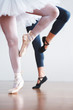 Two ballet dancer's legs practicing on floor