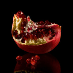 scattered pomegranate seeds and fragments isolated