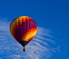 Beautiful balloon against brilliant blue sky