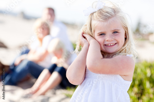 Little Blonde Girl Posing At the Beach