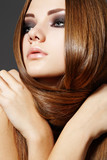 Hairstyle. Beautiful model with long shiny hair
