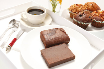 Chocolate brownies in a breakfast setting