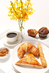 Assorted breakast pastries and orchid flowers