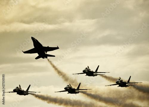 Leinwanddruck Bild Silhouetted Airplanes on Dramatic Sky