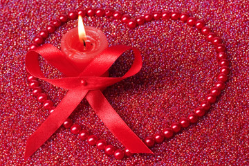 birning candle with red beads