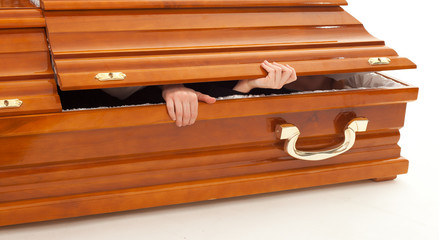 brown coffin with hands, on the white background