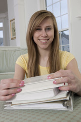 Teenage girl smiling with her school books