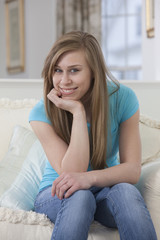 Teenage girl relaxing at home