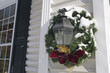 Christmas wreath on light fixture at home entrance