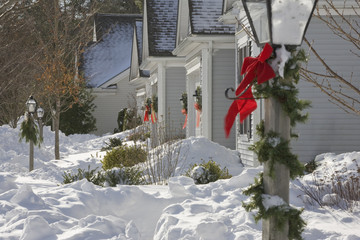 Suburb homes at Christmas in the snow
