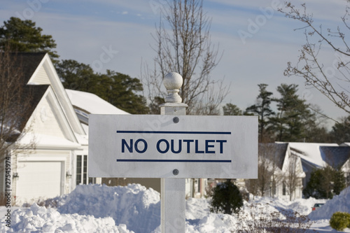 No Outlet sign at end of suburb street in winter