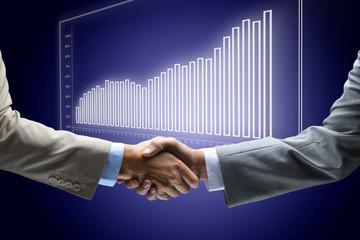 Handshake - Hand holding on black background