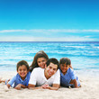 Happy family portrait by the blue beach