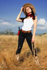 Beautiful cowgirl in a cowboy hat