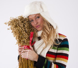 Happy friendly woman with a sheaf of Oats, Christmas tradition i