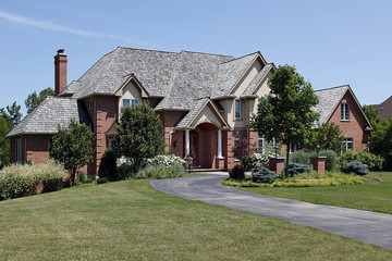 Large brick home with cedar roof