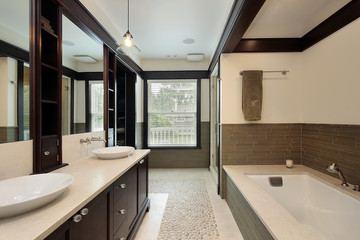Master bath with dark wood trim