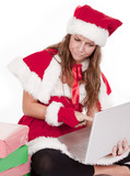 Mrs Santa pointing at computer with a scowl poster
