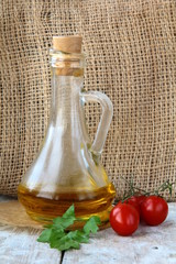 Bottle with olive oil  on a wooden board