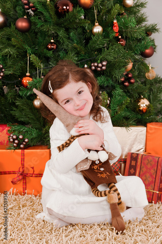 Little girl playing at Christmas