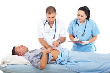 Doctor examine patient in hospital bed