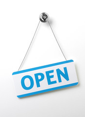 process blue angled open door sign on a silver chain on a white