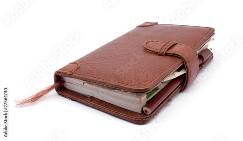 Brown old notebook isolated on white background