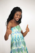 Cute happy african girl smiling thumbs up