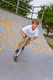 boy enjoys riding his scooter - Fine Art prints