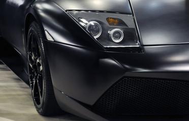 Headlight of a black sports car