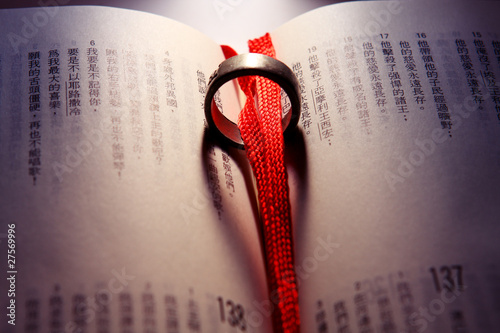 Wedding Ring on a chinese bible