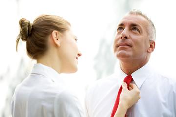 Secretary tying a tie