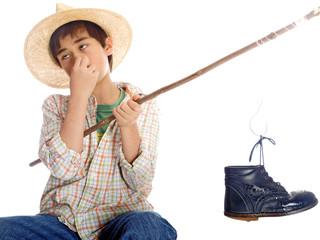 boy fishing catching a stinking shoe