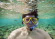 man with a goggles in the sea