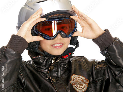 smiling boy wearing helmet, goggles and leather jacket